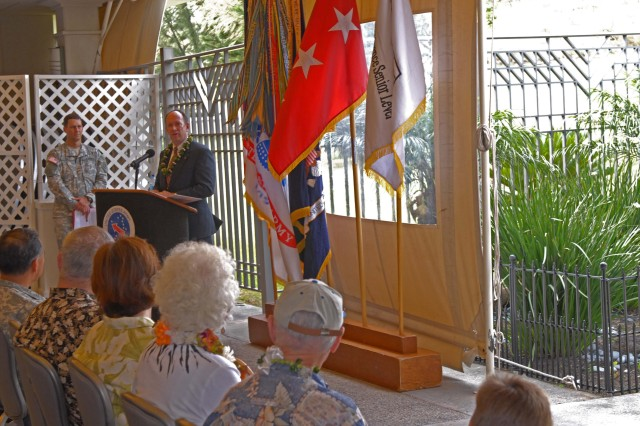 FORT SHAFTER, Hawaii - Mr. Jim Scofield, Defense Intelligence Senior Level Special Advisor to Army Intelligence, speaks at his promotion ceremony.