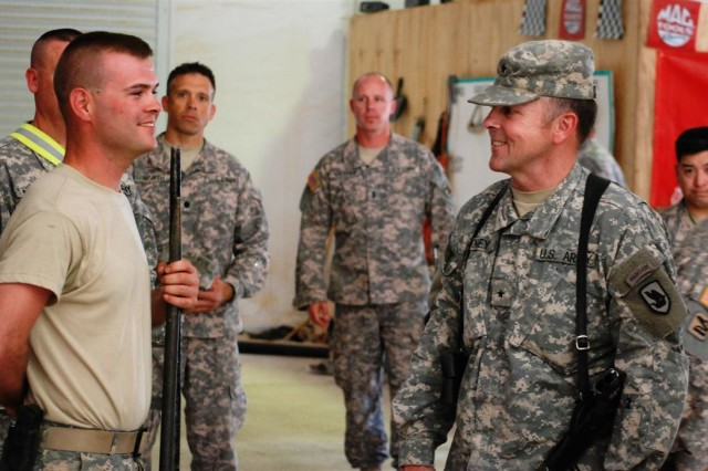 Brig. Gen. Gordon Toney, assistant adjutant general, Washington Army National Guard, speaks with Soldiers from Headquarters and Headquarters Battery, 2nd Battalion, 146th Field Artillery Regiment, out of Olympia, Wash., at Contingency Operating Base Q-West, Iraq May 28.