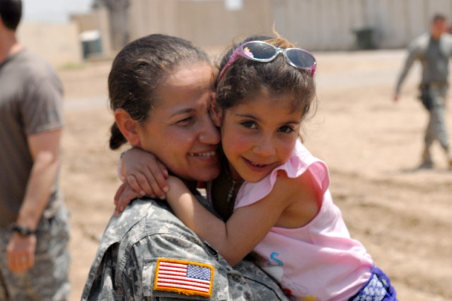 Tiba, 6, hugs a U.S. Soldier just before her trip home to Balad, Iraq. Tiba and her mother traveled to Portland, Maine, where Tiba received life-saving heart surgery as part of Operation Good Heart.