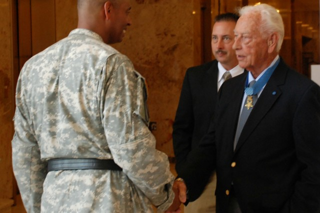 Walt Ehlers, Big Red One recipient of the Congressional Medal of Honor during World War II, talks with Maj. Gen. Vincent Brooks, commanding general of the 1st Infantry Division and Fort Riley, on June 6 in the lobby of the Eisenhower Presidential Library.