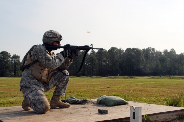 Pfc. Michael Hartz, Company D, 1st Battalion, fires at a target while qualifying with his M-4 rifle.  Hartz shot 28 of the 40 targets.