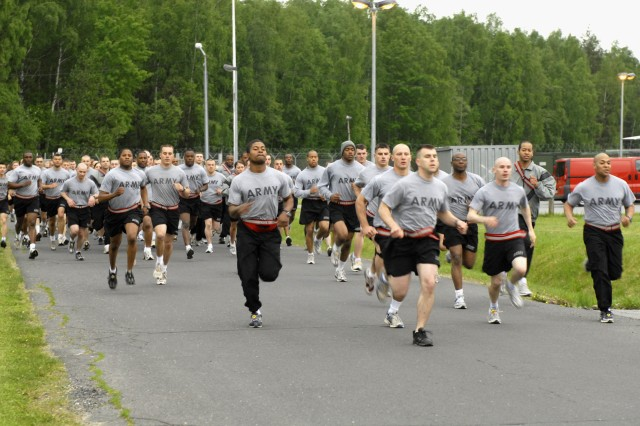 Soldiers from Alpha Company of the 7th Army NCO Academy's Warrior Leaders Course begin their two-mile run for the Army Physical Fitness Test in Grafenwoehr, Germany, May 14, 2009.