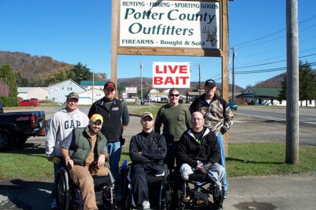 Wounded warriors visiting the LEEK Hunting and Mountain Preserve pose for a group photo outside the Potter County Outfitters in Oswayo, Pa. Standing left to right are Jeremy Henderson, Ed Easton, Ryan Ferre and Ross Colquhoun. Sitting left to right are Josh Ferguson, Jace Badia and Jason Letterman.