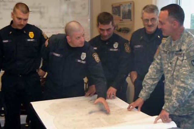 Heroic Employees Review Plans with Blue Grass Commander