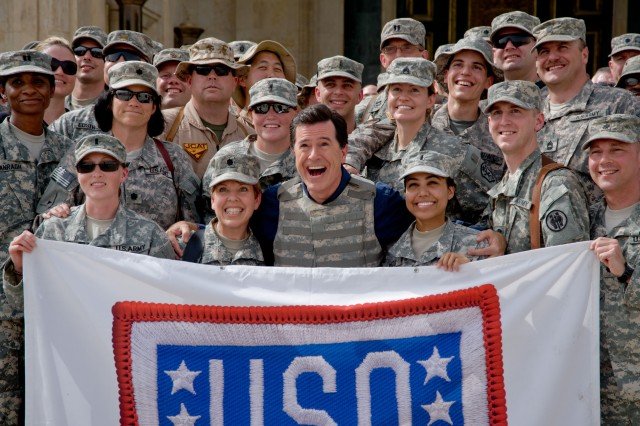 Stephen Colbert takes a photo op with servicemembers at Camp Victory's Al Faw Palace in Baghdad, Iraq, June 5.