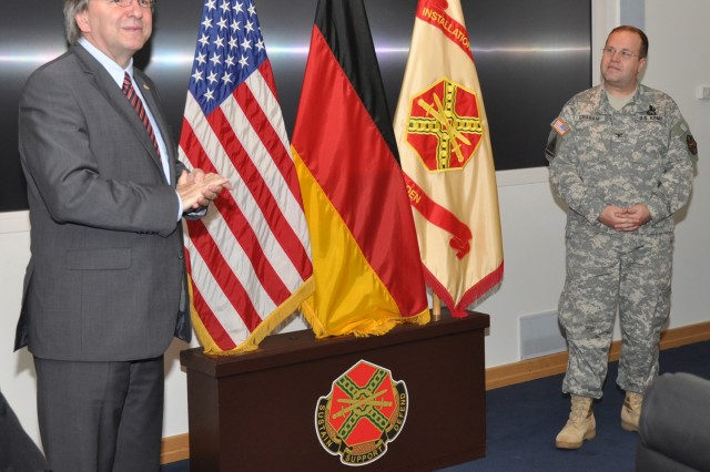 Wiesbaden Lord Mayor Dr. Helmut MAfA1/4ller talks about the close ties between the city and U.S. military during Col. Ray A. Graham's retirement ceremony July 11.