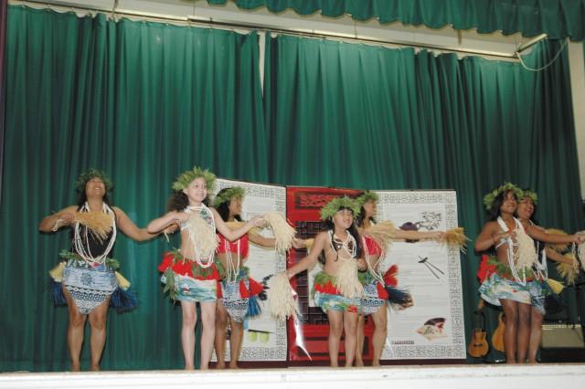 The Pacific Islanders from left, Charlotte Harris, Tiera Harris, Carrina Pena, Kiana Williams, Celicia Pena, Cierra Pena and Liz Williams perform a traditional Tahitian dance during the Asian-