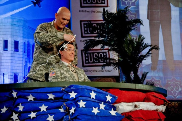 """Multi-National Force-Iraq Commander Gen. Ray Odierno helps Stephen Colbert become more """"Soldierly"""" by shaving his trademark hair in Monday's episode of """"The Colbert Report."""" Colbert filmed a week of episodes from Camp Victory's Al Faw Palace in Baghdad, Iraq, as part of a USO tour."""