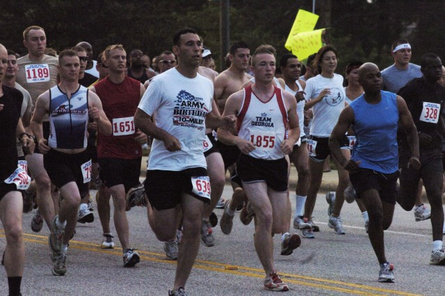 Shaun Colquhoun, 639, Theodore Tarbush, 1855 and John Shipley, 1651 were among the more than 1,800 runners who participated in the 13th Annual Army Birthday 10-Mile race at Fort Bragg Thursday.