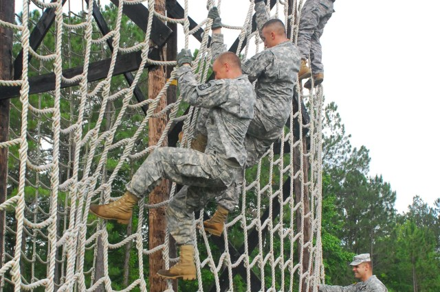 Soldiers from Battery A, 1/76 FA, challenge the Fort Stewart Confidence Obstacle Course, June 5.