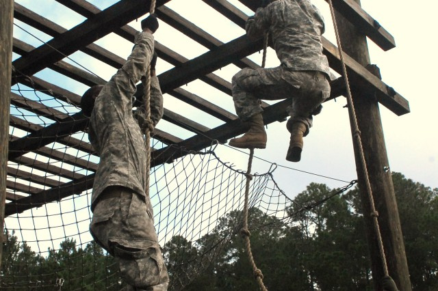 Soldiers with 1/76 FA test their strength during the rope climb segment of the Fort Stewart Confidence Obstacle Course, June 5.