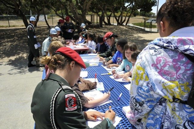 PRESIDIO OF MONTEREY, Calif. -- After their performance, the Seaside High School JROTC students participated in arts and crafts with the Porter Youth Center children in making Army birthday artwork that will be used to decorate the center.