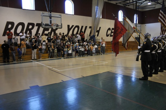 "PRESIDIO OF MONTEREY, Calif. -- The Seaside High School Junior Reserve Officer Training Corps color guard lead the children of the Porter Youth Center on Ord Military Community in the singing of ""The Star Spangled Banner.""  The JROTC drill team then performed to help the Army celebrate its 234th birthday."