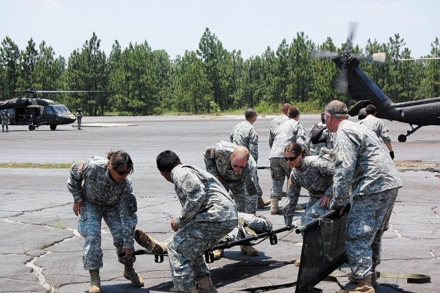 FORT GORDON, Ga.--Litter training team members move through work-up drills teaching medical personnel how to safely move injured personnel onto and off an aircraft during the Global Medic exercise at Fort Gordon June 9, 2009