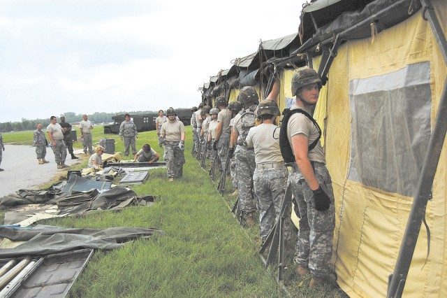 FORT GORDON, Ga.--All hands in the 548th and 305th Combat Support Hospital advance party participate in setting up a minimal care two-ward, 20 patient facility to provide emergency care.