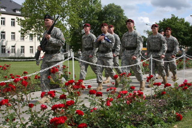 SCHWEINFURT, Germany - Soldiers and community members joined in the singing of the Army song followed by the lowering of the flag to the familiar tune of the bugle during the Army birthday celebration June 11. Soldiers of 1st Squadron, 91st Cavalry Regiment march off with the colors, concluding the day's honorary events which consisted of an opening prayer given by the garrison chaplain Lt. Col. Thomas Wesley, a speech from garrison commander Lt. Col. Anthony Haager, and a cake-cutting performed by garrison Command Sgt. Maj. Ernest Lee.