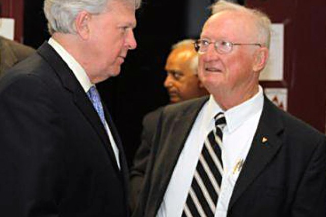 AMRDEC director Dr. Bill McCorkle, right, talks with U.S. Rep. Parker Griffith on June 8 at Alabama A&M University.