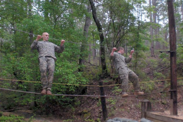 Capt. Robert Killian and 1st Lt. Grant Barge, both from 5th Battalion, 25th Field Artillery, 4th Infantry Brigade Combat Team, 10th Mountain Division, negotiate a rope-bridge obstacle at Fort Benning, Ga., during the annual Best Ranger competition May 8-10.