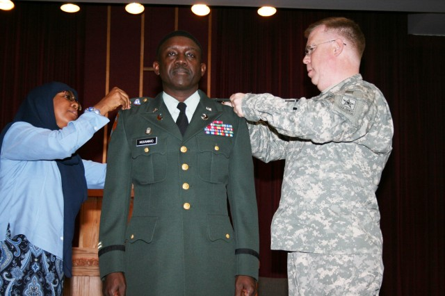 Chaplain Abdul-Rasheed Muhammad is promoted to lieutenant colonel in a ceremony Friday at the Main Post Chapel. Muhammad was the first Muslim chaplain in the armed forces. Pinning on his new rank were his wife Saleemah and Brig. Gen. Donald Rutherford, deputy chief of chaplains.