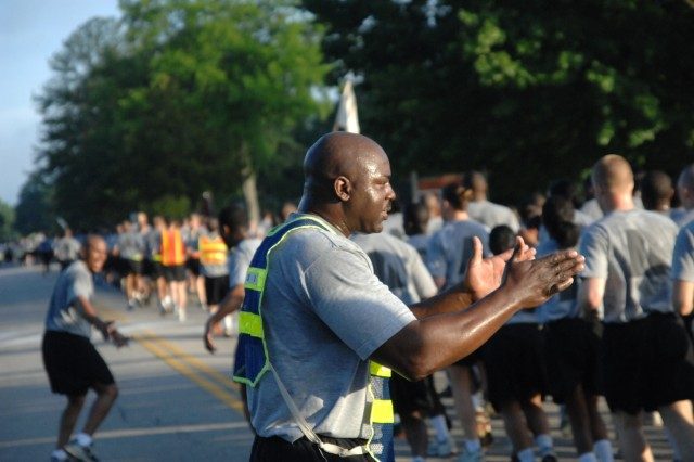 Command Sgt. Maj. Michael Gilmore, 23rd Quartermaster Brigade command sergeant major, encourages his runners. Thousands of Soldiers, Marines and Civilians joined in the annual Army Birthday Run June 12 at Fort Lee, Va. Photo by Mike Strasser