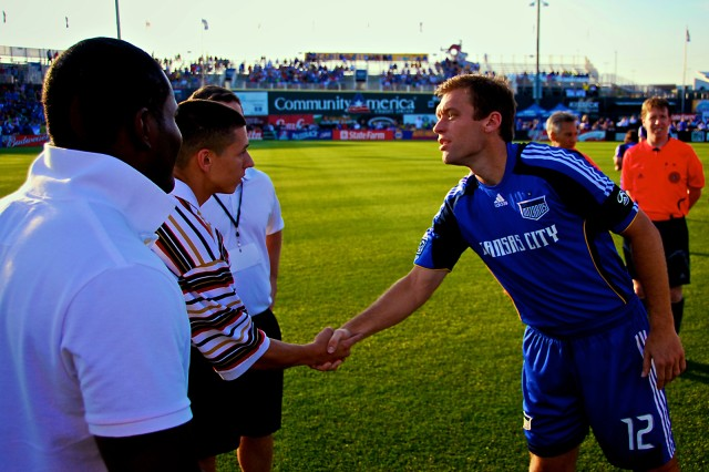 Kansas City Wizards defender and team captain Jimmy Conrad shakes hands with Combined Arms Center and Fort Leavenworth 2009 Soldier of the Year Spc. Thomas Rincon, as CAC and Fort Leavenworth 2009 Noncommissioned Officer of the Year Sgt. Jovan Luna looks on, before the pre-game coin toss at the Kansas City Wizards Fort Leavenworth Military Appreciation Night June 6 at CommunityAmerica Ballpark in Kansas City, Kan.