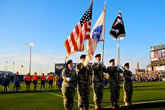 The Medical Activity Color Guard - consisting of Spc. Jessica Goldhorn, Sgt. Joseph O'Neill, Sgt. Charles Cannella, Sgt. Timothy Turpin and Sgt. Beverly Bradshaw - presents the colors at the Kansas City Wizards Fort Leavenworth Military Appreciation Night June 6 at CommunityAmerica Ballpark in Kansas City, Kan.
