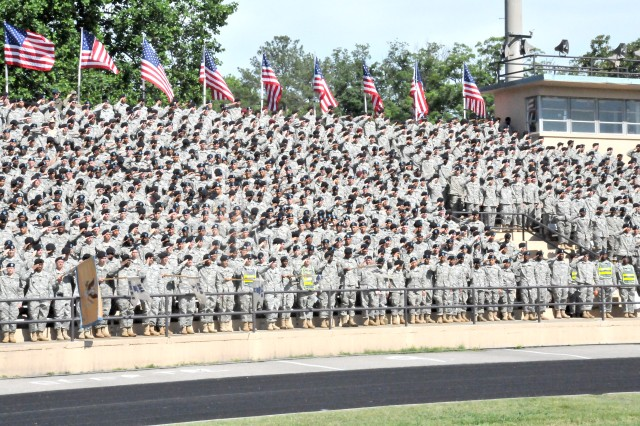 Soldiers with the 244th Quartermaster Battaltion, 23rd Quartermaster Brigade salute the American Flag during Fort Lee's Army Birthday Celebration, Friday. The installation celebrated the Army's 234th birthday with traditional ceremonies followed by a day of recreational activites for the troops and their Families. Photo by Kimberly Fritz, Fort Lee Public Affairs.