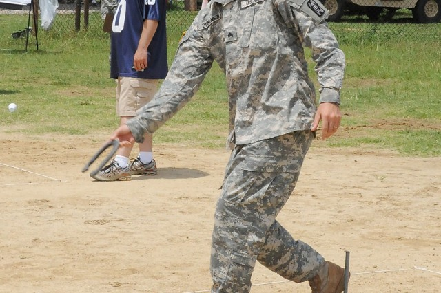 Sgt. William Dickenson, 148th Quartermaster Co., 530th Combat Sustainment Support Battalion, 49th QM Group, plays horseshoes during the 49th QM Group's Army Birthday celebration June 12. (Photo by Amy Perry)