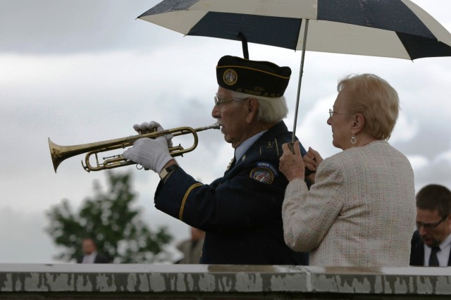 "Ninety-year-old World War II Veteran Tuck Marcantonio, Disabled American Veterans Department of Utah, plays ""Taps"" during the burial service for Medal of Honor recipient retired Maj. George E. Wahlen, June 11."
