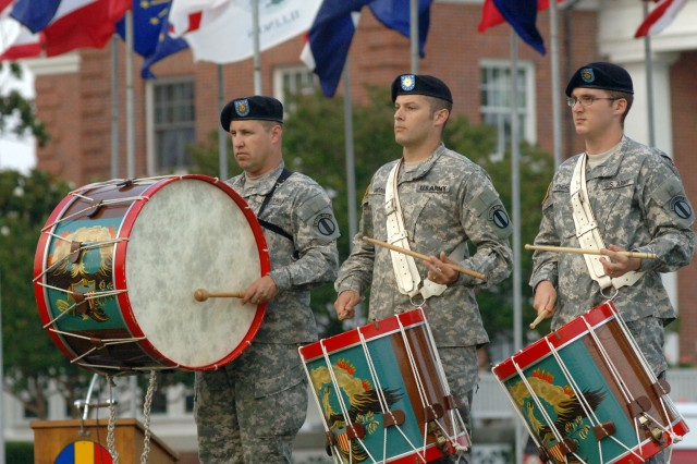 Master Sgt. James Kruczek, left, Sgt. James Landrum, center, and Spc. Jonathan Scheibler from the U.S. Army Training and Doctrine Command Band perform a spotlight percussion solo during the June 11 Army Birthday Concert at Fort Monroe, Va. The evening event also included a precision rifle drill demonstration by the U.S. Army Drill Team from the 3rd U.S. Infantry Regiment (Old Guard), Fort Myer, Va.