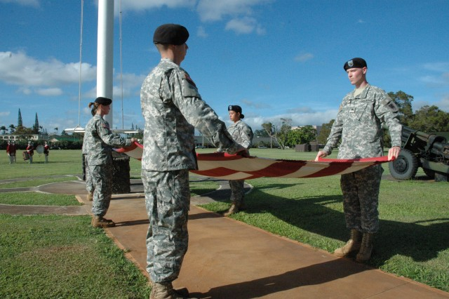 <p>SCHOFIELD BARRACKS, Hawaii -- <b>Step 3: Detail, step</b> - Firmly grabbing the edges of the flag, the detail steps away from each other and pulls the flag taut.</p><p>Flag detail members include Staff Sgt. Gordon Molina, noncommisioned officer, and Specialists Autumn Boehm, Larry Carter, John Ingoglia, Kimberly Quinene, David Rund, and Raul Velasquez. Specialists Shawn Ivey and Nathan Drews, cannoneers, are not pictured. All Soldiers are from Headquarters Support Co., 84th Eng. Bn.</p>