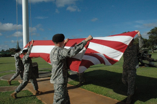 <p>SCHOFIELD BARRACKS, Hawaii -- <b>Step 2: Prepare to fold</b> - The detail comes back together and folds the flag in half twice. </p><p>Flag detail members include Staff Sgt. Gordon Molina, noncommisioned officer, and Specialists Autumn Boehm, Larry Carter, John Ingoglia, Kimberly Quinene, David Rund, and Raul Velasquez. Specialists Shawn Ivey and Nathan Drews, cannoneers, are not pictured. All Soldiers are from Headquarters Support Co., 84th Eng. Bn.</p>