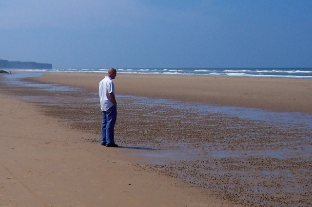 A visitor takes in the view of Omaha Beach as it is today.