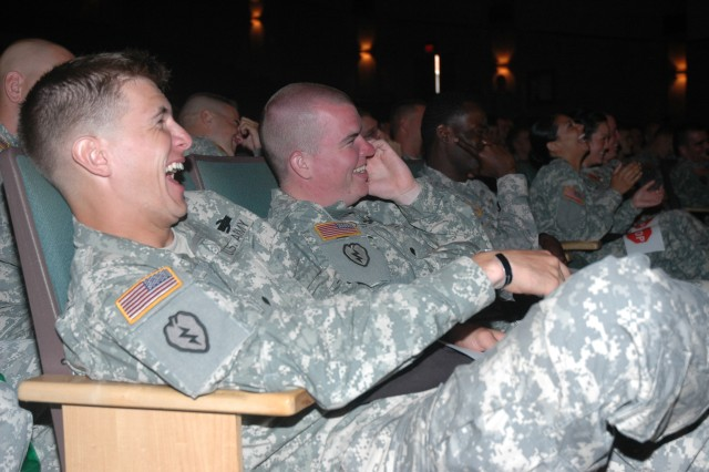 SCHOFIELD BARRACKS, Hawaii - Specialists Joe May, at left, and Jerry Johnson of the 1st Battalion, 21st Infantry Regiment, enjoy a hearty laugh along with other soldiers, during the June 8 presentation of Sex Signals at Sgt. Smith Theater.