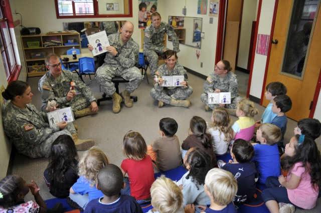 "PRESIDIO OF MONTEREY, Calif. -- Cpt. (CH) Richard West (center) and Soldiers from B Co. 229th Military Intelligence Battalion read ""Sam, the Army Dog,"" to the children of Monterey Road Child Development Center on Ord Military Community for the Army's 234th birthday."
