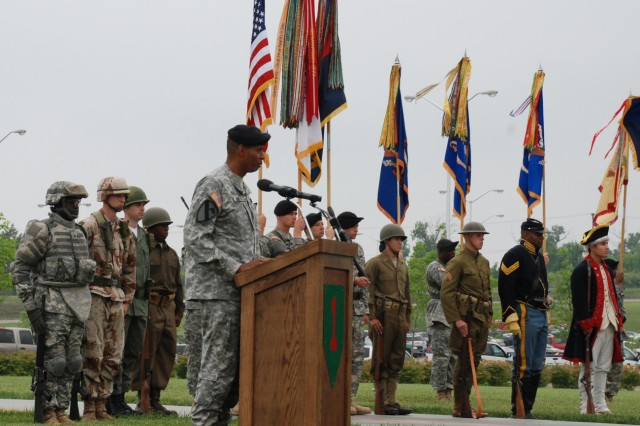 """Maj. Gen. Vincent Brooks, commanding general of the 1st Infantry Division and Fort Riley, speaks to the audience attending the Army's 234th birthday and 1st Inf. Div.'s 92nd birthday celebration held on the parade field in front of division headquarters. Behind him are soldiers dressed in period uniforms from times in the Army's history. (1st Inf. Div. Public Affairs photo by Jordan Chapman)"""""""