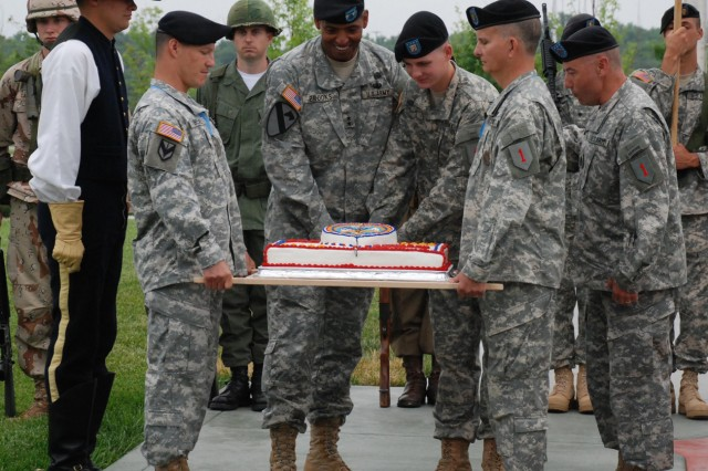 Maj. Gen. Vincent Brooks (center left) and Private Jake Ryan Hoffmann (center right), the youngest Soldier at Fort Riley at 17-years-old, cut the Army's birthday cake with a ceremonial saber June 11 during the Army's 234th birthday and the 1st Infantry Division's 92nd birthday celebration on the parade field in front of division headquarters. (1st Inf. Div. Public Affairs photo by Jordan Chapman)""