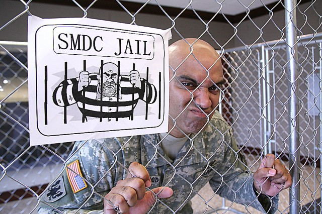 Maj. James Smallwood exhibits his criminal side during U.S. Space and Missile Defense Command/Army Forces Strategic Command's Jail Day on June 10. Smallwood works in G-3 strategy and policy.