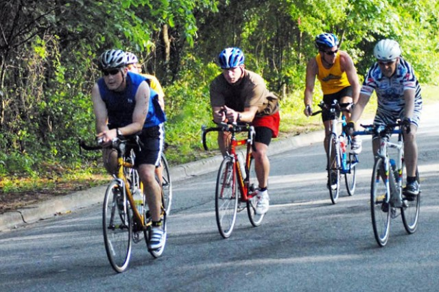 A group of competitors cycle down Sightseeing Road in the first stretch of the 20k bike ride.