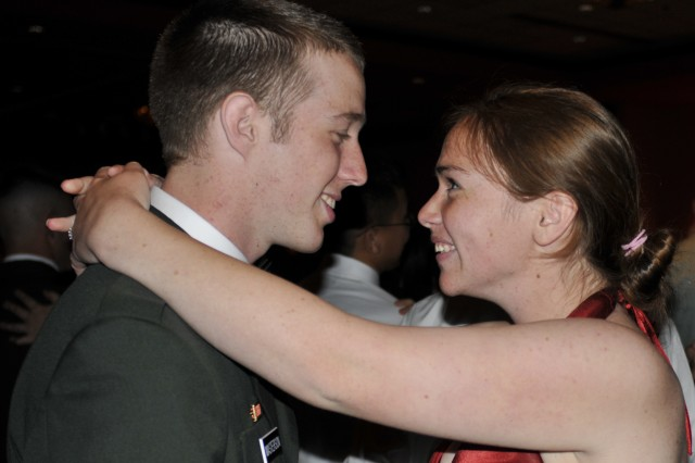"PRESIDIO OF MONTEREY, Calif. -- Pvt. Benjamin Masterson dances with his fiancee, Catherine Aylward, to ""Don't Wanna Miss a Thing,"" by Aerosmith.  Aylward traveled from Athol, Idaho to accompany Masterson to the Army ball to help him celebrate the Army's 234th birthday."