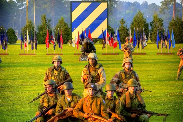 Soldiers from 2nd Brigade Combat, 3rd Infantry Division, stand fast in uniforms from historic eras to commemorate the Army's 234 birthday at Cottrell Field, June 12. This was part of the grand finale during Fort Stewart's first ever Twilight