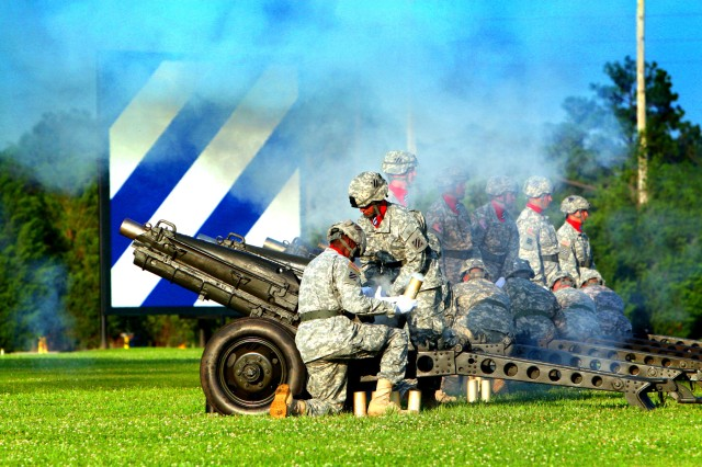 Firing off a mortar round during the 3rd Infantry Division's Twilight Tattoo, Soldiers from 2-3 Brigade Troops Battalion, 2nd Brigade Combat Team, 3rd Infantry Division, mark the start of the Army's 234 birthday celebration at Cottrell Field,