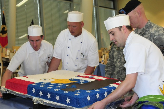 Staff from the U.S. Army Garrison Grafenwoehr Dining Facility position the birthday cake June 11 for the Army birthday celebration.