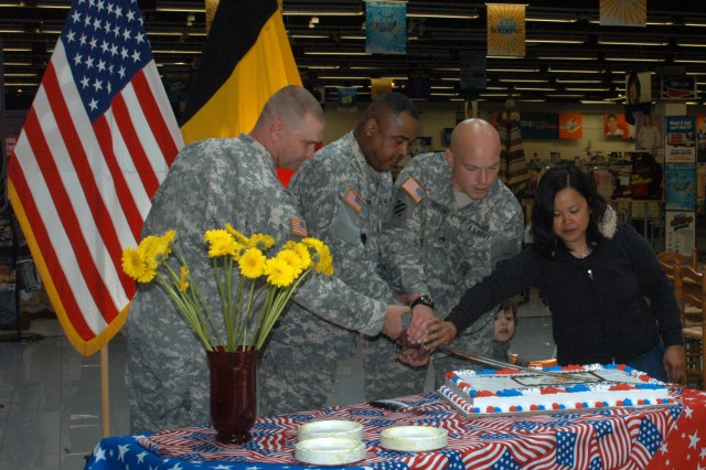 (From left to right): Spc. Christopher Newsom, Command Sgt. Maj. Ralph Ford, Sgt. Patrick Taylor and his wife Cathy Taylor cut the birthday cake at the celebration for the Army's 234th birthday on June 11 at Chièvres Garrison, Belgium. Newsom represented Soldiers serving in the Warriors in Transition Unit, while the military family was represented by the Taylor's. Ford gave a speech before the cake-cutting about the traits and strengths of the noncommissioned officers serving in the Army.