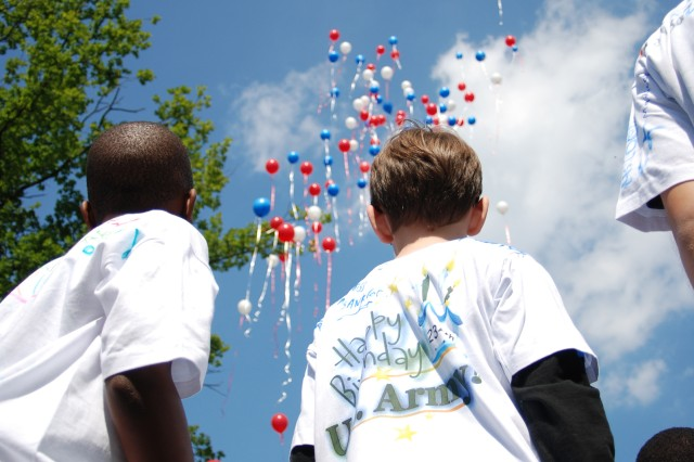 Children on SHAPE, Belgium, at the USAG Benelux School Age Services watch the balloons they released float away. They launched the balloons in recognition of the Army's 234th Birthday. The students also celebrated with birthday cake and special Army Birthday T-shirts.