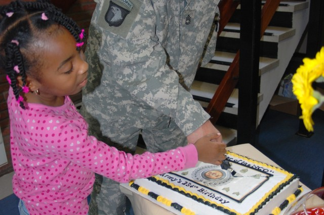 Sgt. 1st Class Kevin Strakal, from the Northern Law Center, and Tiffany Boone Hines, a six-year-old Army dependent, cut the 234th Army Birthday Cake at the USAG Benelux Army Community Service headquarters on SHAPE, Belgium, June 11, 2009. ACS celebrated the Army's birthday with an open house for Servicemembers and Families.