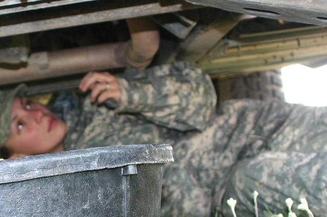 Spc. Tara Jarvis checks equipment for faults before putting it into Network Operations.