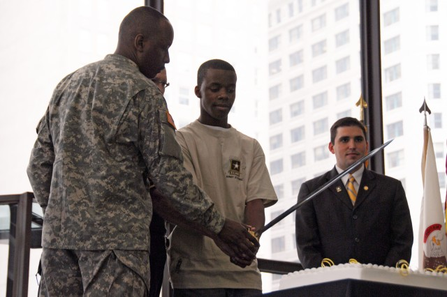 Command Sergeant Major William P. Lindo and Private Phillip Jordan, a Soldier who is scheduled to attend Basic Training later in June, cut the Army Birthday cake while Mr. Dan Grant looks on in Daley Center, Chicago, June 11, 2009.