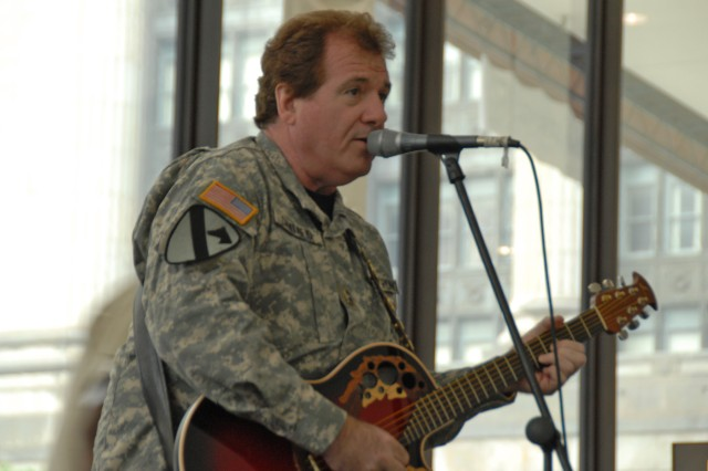Mr. Joe Cantafio, 101st Rock Division performs during the Army Birthday Celebration in Daley Center, Chicago, June 11, 2009.