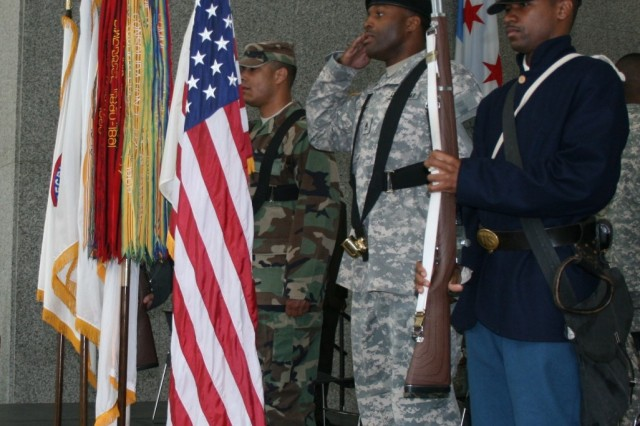 Soldiers from the Chicago Army Recruiting Battalion in period uniforms post the colors during the Army Birthday Celebration in Daley Center, Chicago, June 11, 2009.